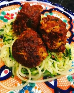 Whole30 Turkey Meatballs on a plate with noodles