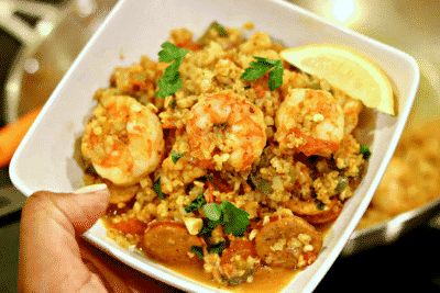 Keto Jambalaya with Cauliflower Rice in a bowl with a lemon wedge