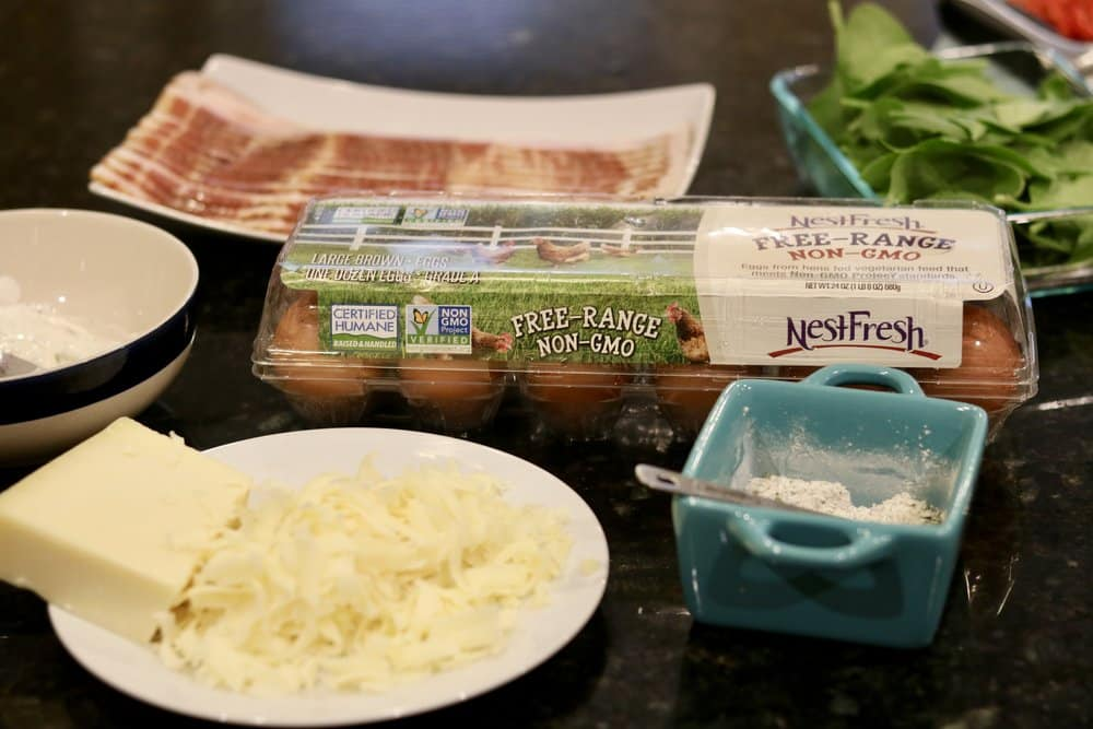 An assortment of ingredients for Quiche in a Bacon Cup
