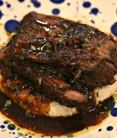 Bone Broth Mississippi Pot Roast over cauliflower with gravy, on a plate