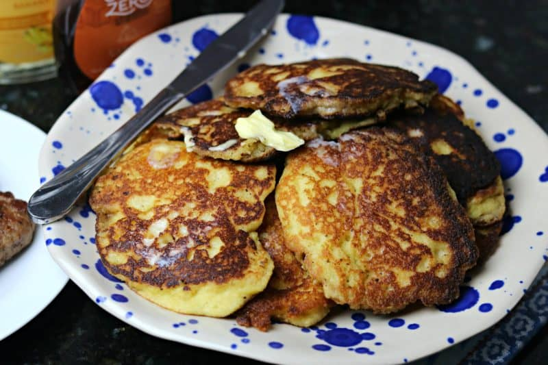 A pile of my Keto Pancakes recipe on a plate with salted butter on top