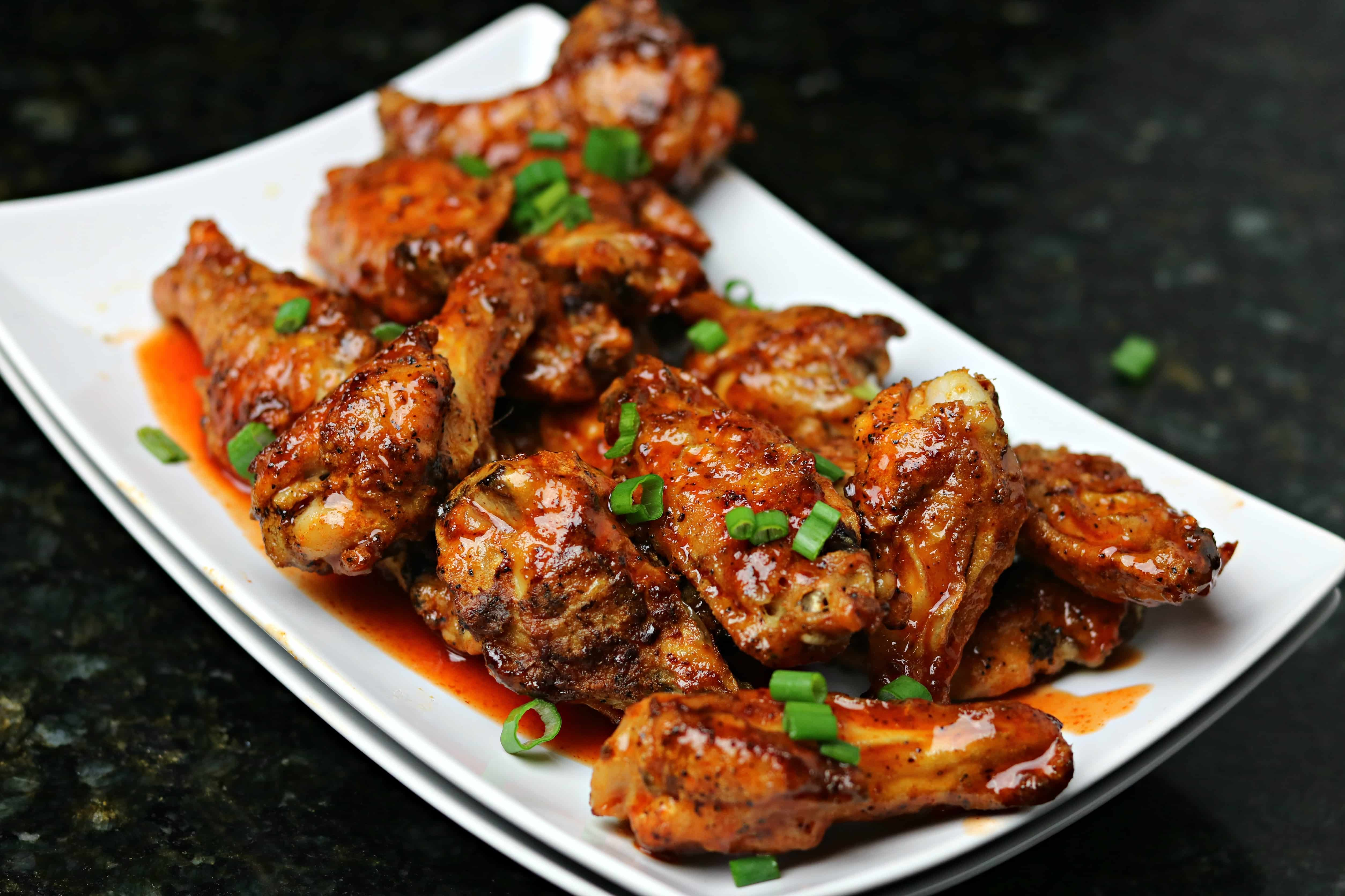 Honey Sriracha Chicken Wings on a white Plate