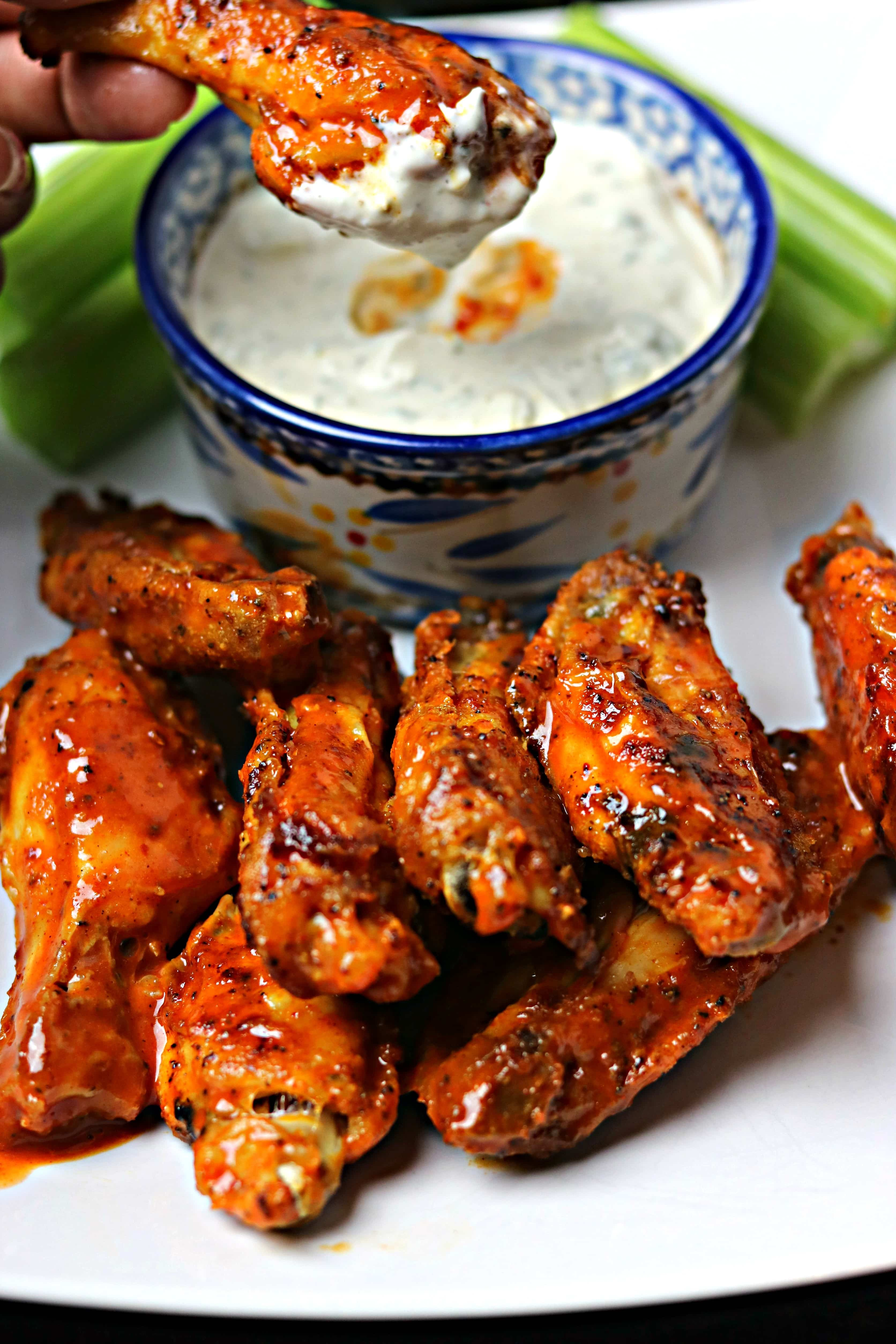 Air Fryer Buffalo Wings with blue cheese dip on a white plate