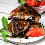Low-Carb Stuffed French Toast with berries on a white plate