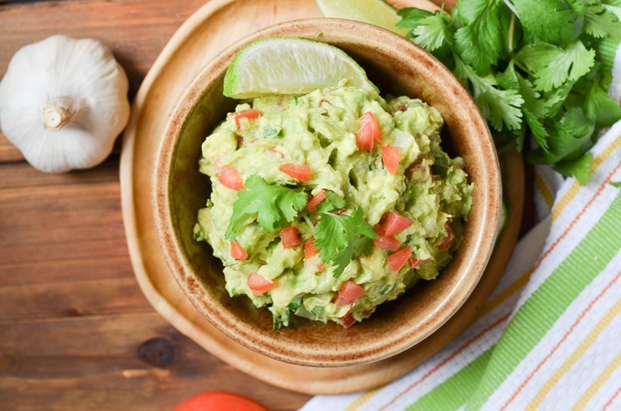 Easy Guacamole in a brown serving dish