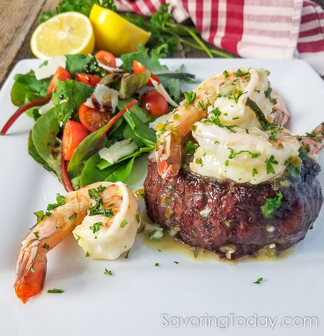 Grilled Steak and Shrimp Scampi served on a white dish