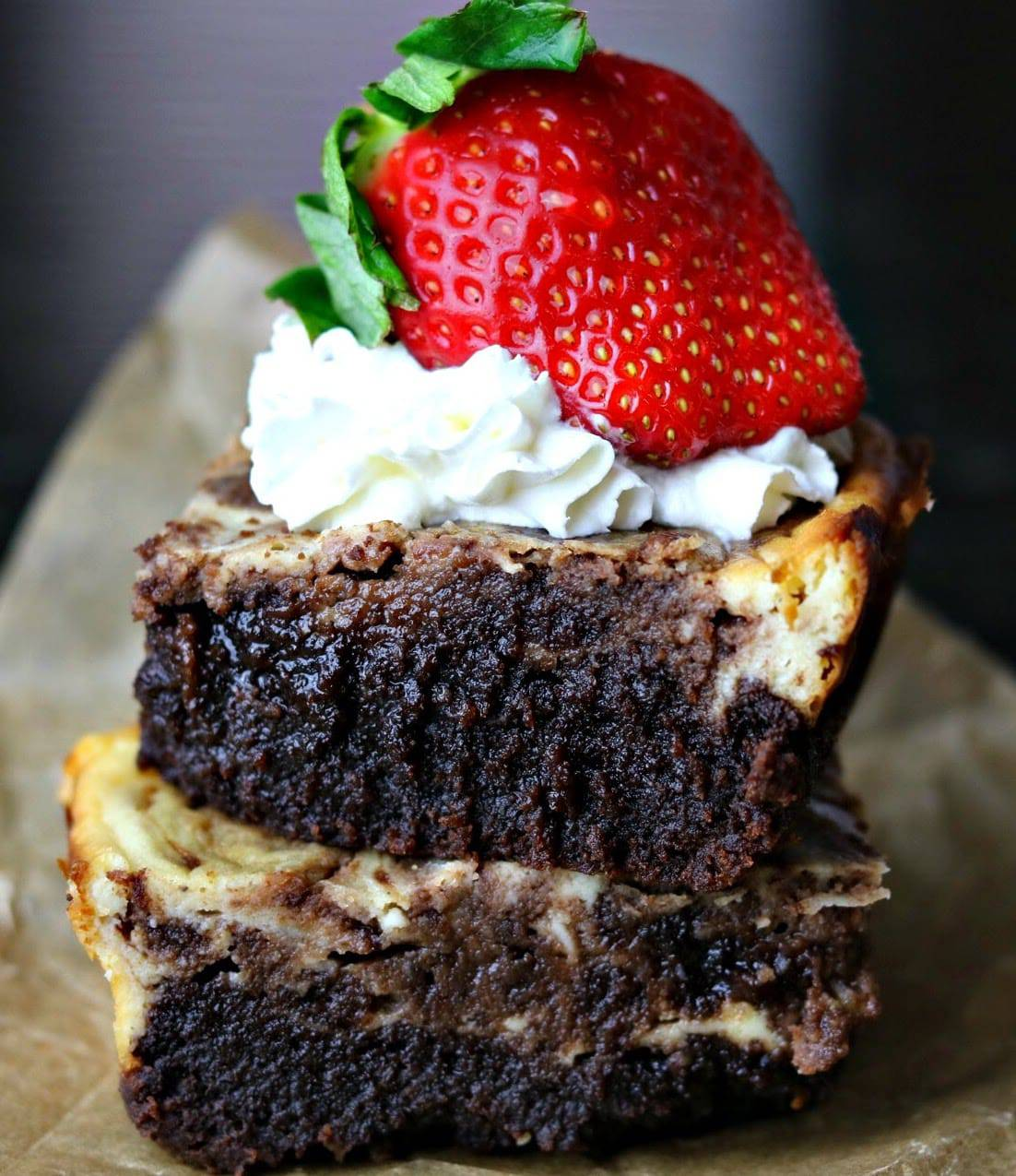 Keto Cheesecake Brownies stacked on top of each other