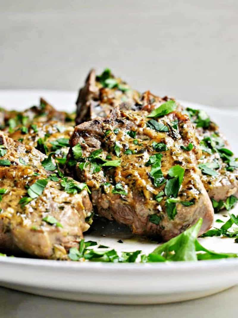 Roasted Lamb Chops on a white serving dish