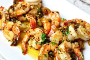 garlic shrimp scampi on a white serving dish