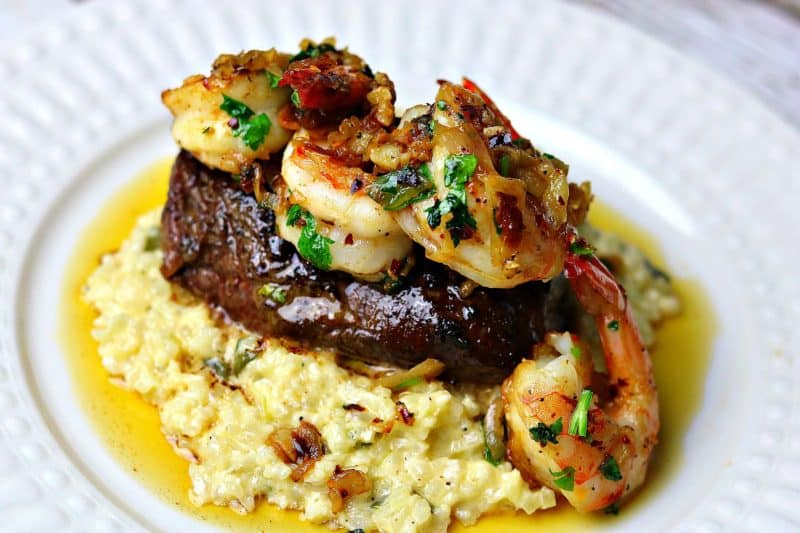The Ultimate Keto Surf & Turf recipe, featuring juicy, rosemary-flavored filet mignon steaks and Keto Shrimp Scampi. I served this on top of Cauliflower Risotto for a complete restaurant quality meal. #keto #ketorecipes #shrimpscampi #surfandturf #lowcarbrecipes #cauliflowerrisotto #datenightdinner #dinnerideas #fancydinner #ketodinner