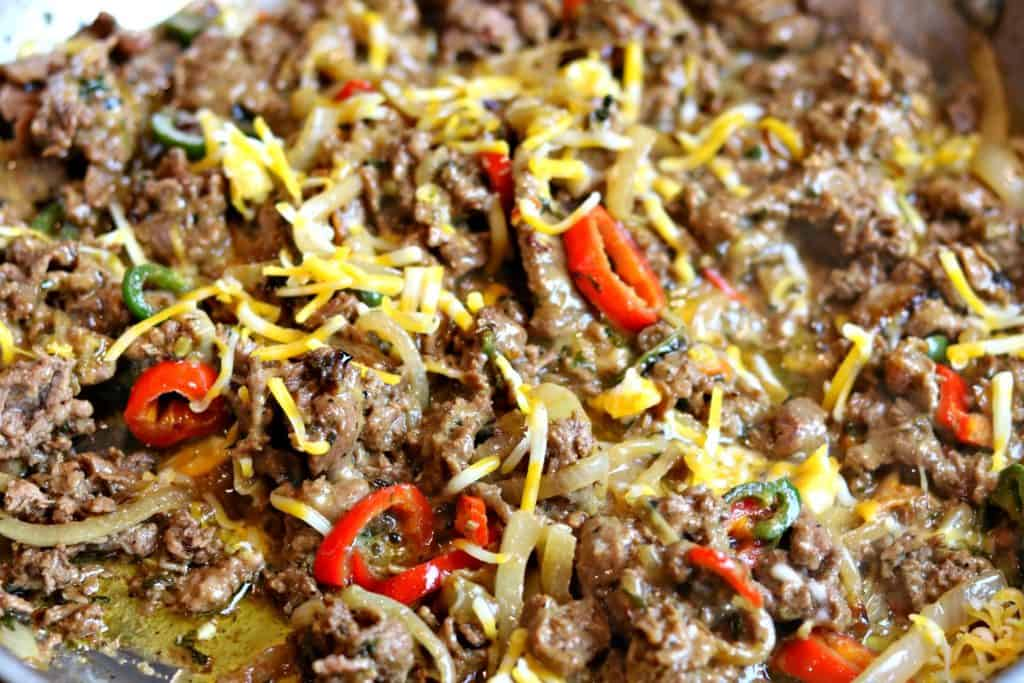 A close up of Philly Cheesesteak with roasted bell peppers.