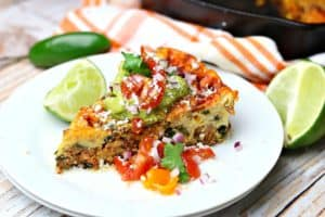 Baked Mexican frittata recipe on a plate with toppings