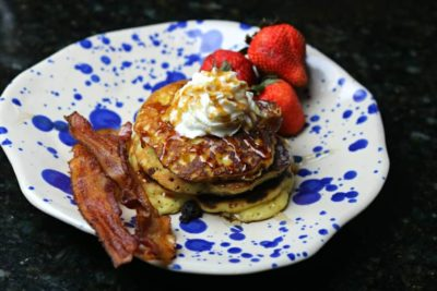 keto almond flour pancakes on a plate with strawberries and bacon