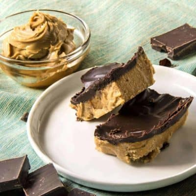 No Bake Chocolate Peanut Butter Bars on a white plate