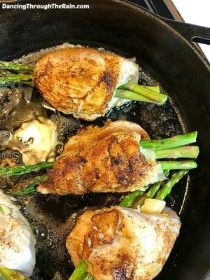 Asparagus-Stuffed Chicken Breast in a Cast Iron Skillet