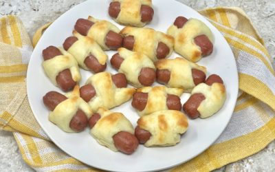 keto pigs in a blanket recipe on a white plate