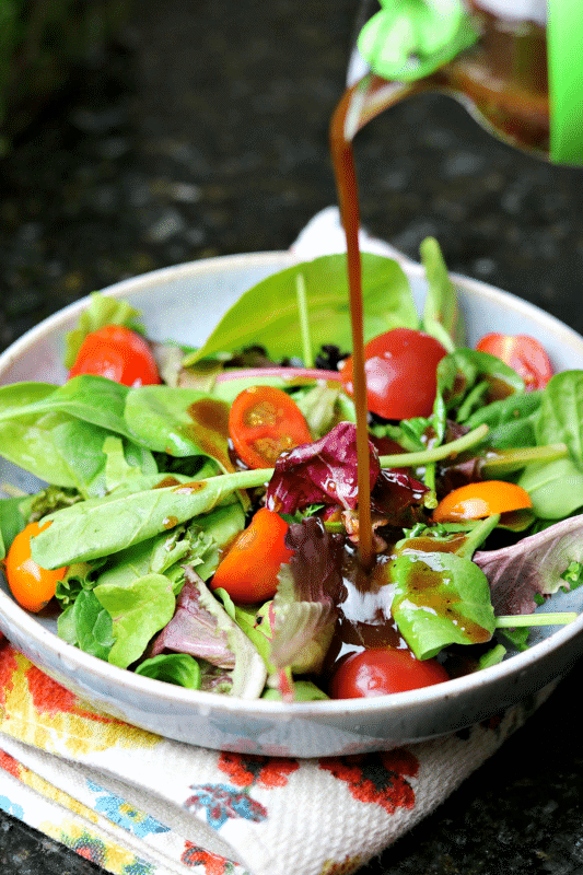 Keto Balsamic Vinaigrette being poured on a salad