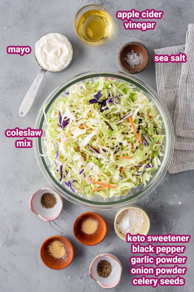the ingredients for keto coleslaw on a flat surface with name labels
