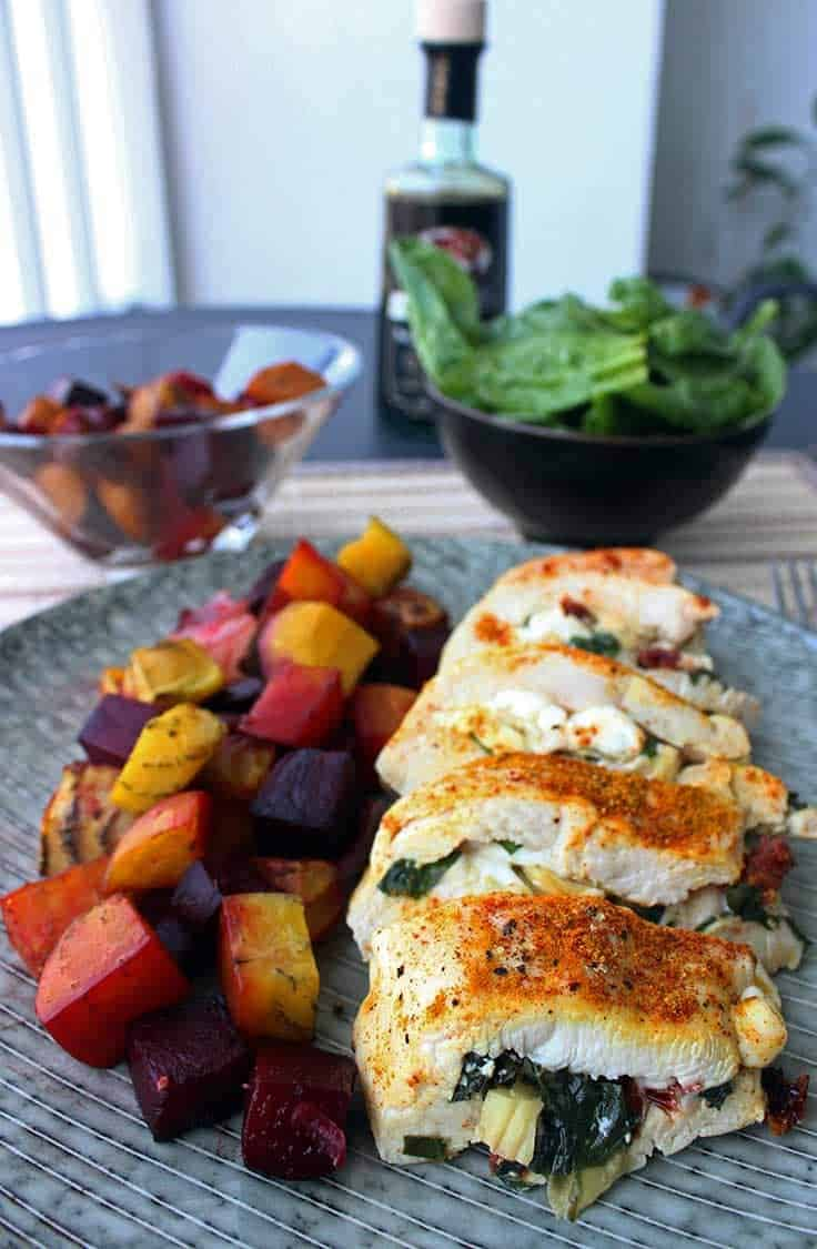 Stuffed Chicken Breast on a plate with vegetables