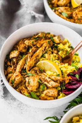 Keto Chicken Shawarma in a white bowl garnished with lemon.