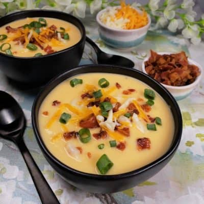 Two bowls of Instant Pot Low-Carb Cheesy Cauliflower Soup
