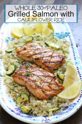grilled salmon on a plate with cauliflower rice