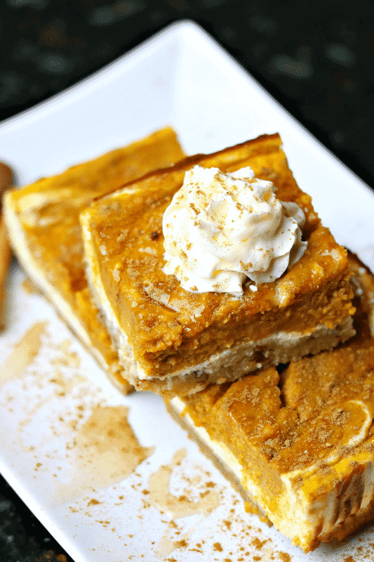 Keto Pumpkin Bars stacked on a white plate