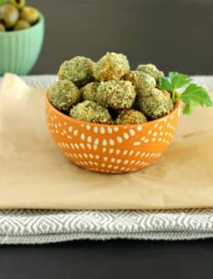 Oven-Fried Stuffed Olives stacked in a small orange bowl