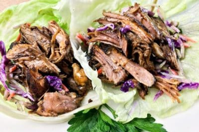 Lettuce leaves filled with pulled pork and vegetables