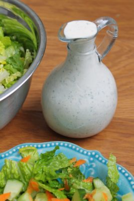 Carafe of Pickle Juice Ranch Dressing with salad