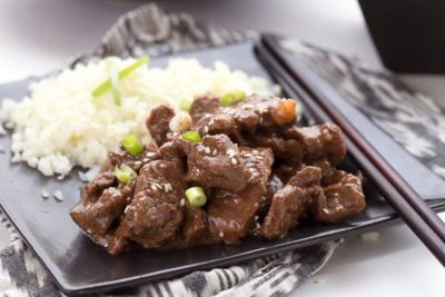 A plate of keto Mongolian Beef with a side of cauliflower rice