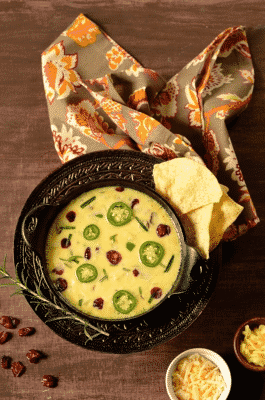 Cranberry jalapeno queso fundido dip in a black serving dish