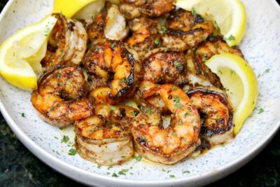 cast iron seared shrimp in a bowl with lemon