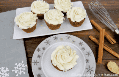 GINGERBREAD CUPCAKES WITH CREAM CHEESE FROSTING on white serving dishes
