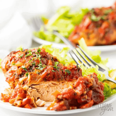 Slow Cooker Chicken Cacciatore on a white plate with a fork.