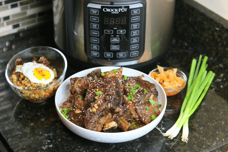 Keto Korean BBQ Ribs in a bowl with side dishes