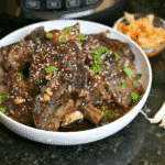 Keto Korean BBQ Ribs in a Bowl with green onions & kimchi