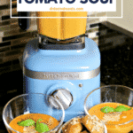 Easy Low Carb Tomato Soup recipe in a bowl with a blender behind it