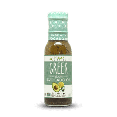 A bottle of Primal Kitchen Green Vinaigrette with Avocado oil
