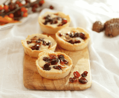 SAVORY BACON CRANBERRY CHEESE TARTLETS on a wooden board