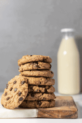 Sugar-Free Chocolate Chip Cookies beside a glass bottle of milk