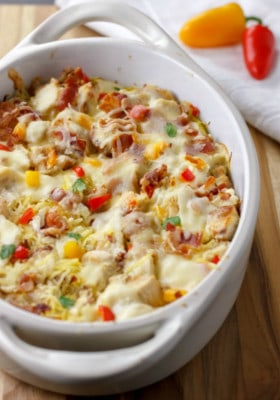 BACON CHICKEN ALFREDO SQUASH NOODLE BAKE in a white baking dish