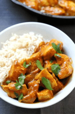 Easy Dairy-Free Indian Butter Chicken with white rice on a white serving dish