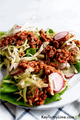 Ground Turkey Lettuce Wraps with Creamy Cilantro Slaw on a white serving dish