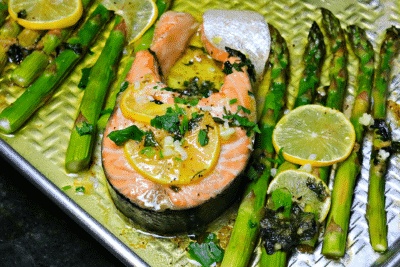 Finished salmon steak with asparagus