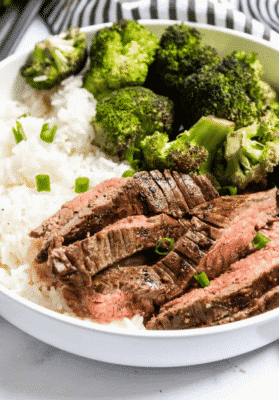 Marinated Sheet Pan Steak and Broccoli in a white serving dish
