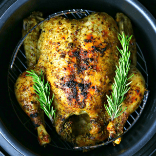 a close-up of the Crock-pot Express with a cooked whole chicken inside it