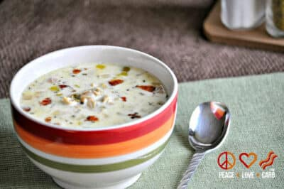 Low-Carb Slow Cooker Clam Chowder in a striped-colored bowl with a spoon.
