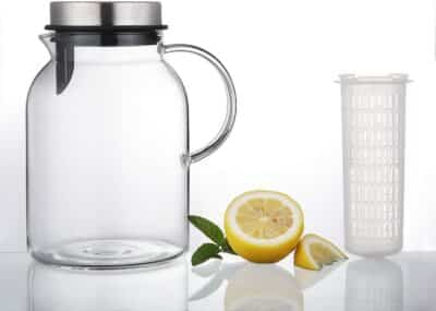 The Hiware Water Pitcher on a table next to half a lemon.