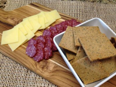keto everything crackers on a board with salami and cheese
